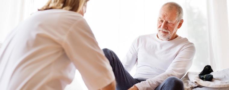 Diabetic elderly man receiving routine foot care